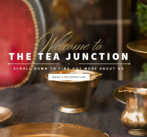 <span>The Tea Junction</span><i>→</i>